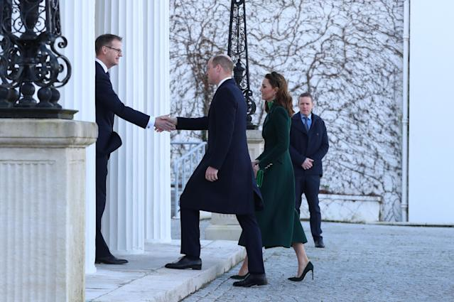 The Duke and Duchess of Cambridge are greeted by Art O'Leary, Secretary General to the President. (Press Association)