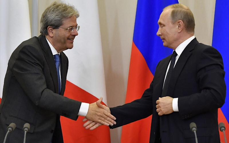 Russian President Vladimir Putin, right, and Italian Prime Minister Paolo Gentiloni attend a joint news conference at the Bocharov Ruchei state residence in Russian Black Sea resort of Sochi on Wednesday, May 17, 2017. - Credit: Yuri Kadobnov/ POOL AFP