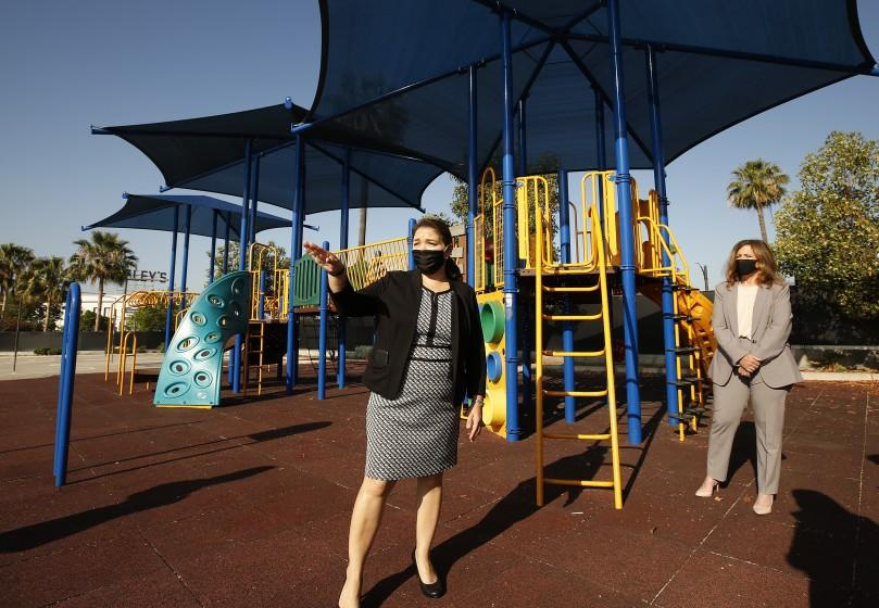 "Cerritos Elementary School Principal Perla Chavez-Fritz, left, shows her Glendale campus to L.A. County schools Supt. Debra Duardo. School districts statewide face decisions on how and when to reopen their campuses. <span class=""copyright"">(Al Seib / Los Angeles Times)</span>"