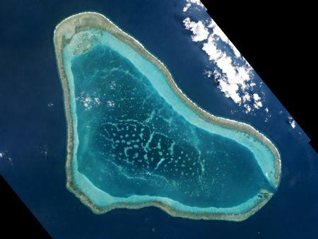 Boats at Scarborough Shoal in the South China Sea are shown in this handout photo provided by Planet Labs