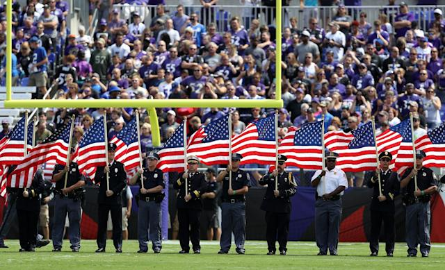 <p>First Responders carry flags prior to the Buffalo Bills vs. the Baltimore Ravens game at M&T Bank Stadium on September 11, 2016 in Baltimore, Maryland. (Photo by Patrick Smith/Getty Images) </p>