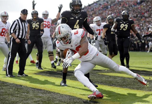 Ohio State wide receiver Chris Fields scores a touchdown on a catch against Purdue during the first half of an NCAA college football game in West Lafayette, Ind., Saturday, Nov. 2, 2013. (AP Photo/Michael Conroy)
