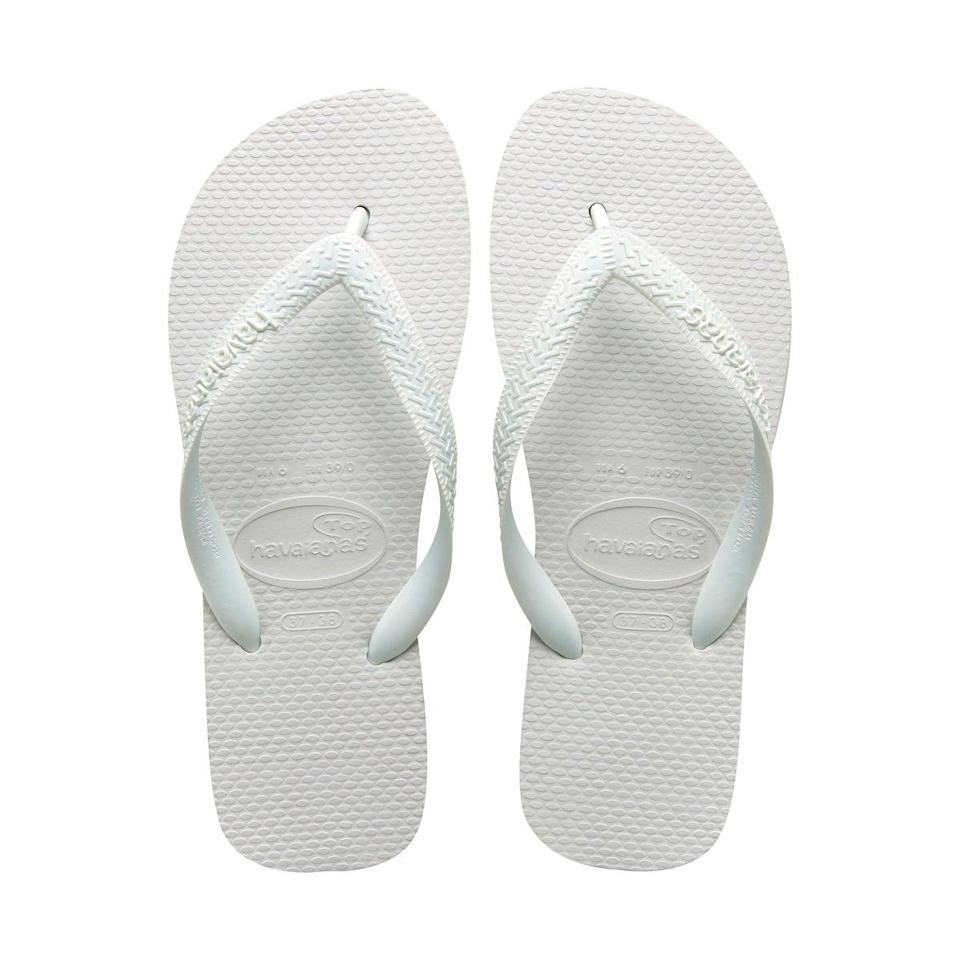 """<h3>Havaianas Top Flip Flops</h3> <br>At less than $20, you <em>could</em> just let your Havaiana flip-flops get a little dirty — but, if you'd like to do something about those foot imprints that are getting more and more noticeable...<br><br><strong>Cleaning Hack: </strong>...You can scrub with them with a <a href=""""https://www.wikihow.com/Clean-White-Flip-Flops"""" rel=""""nofollow noopener"""" target=""""_blank"""" data-ylk=""""slk:baking soda solution"""" class=""""link rapid-noclick-resp"""">baking soda solution</a> to remove discoloration.<br><br><strong>Havaianas</strong> Top Flip Flops, $, available at <a href=""""https://go.skimresources.com/?id=30283X879131&url=https%3A%2F%2Fus.havaianas.com%2Fshop-now%2Fwomens-footwear%2Ftop-white-366.html"""" rel=""""nofollow noopener"""" target=""""_blank"""" data-ylk=""""slk:Havaianas"""" class=""""link rapid-noclick-resp"""">Havaianas</a><br><br><strong>Arm & Hammer</strong> Baking Soda, $, available at <a href=""""https://www.amazon.com/Arm-Hammer-Baking-Soda-Value/dp/B00B7K97UQ/ref=asc_df_B00B7K97UQ/"""" rel=""""nofollow noopener"""" target=""""_blank"""" data-ylk=""""slk:Amazon"""" class=""""link rapid-noclick-resp"""">Amazon</a><br><br><br>"""