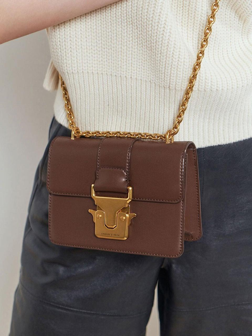 <p>This <span>Charles &amp; Keith Double Handle Metallic Push-Lock Shoulder Bag</span> ($56) will be your new brunch accessory.</p>