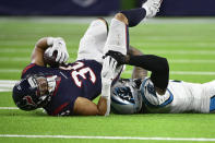 Houston Texans running back Phillip Lindsay (30) is tackled by Carolina Panthers cornerback Jaycee Horn during the second half of an NFL football game Thursday, Sept. 23, 2021, in Houston. (AP Photo/Justin Rex)