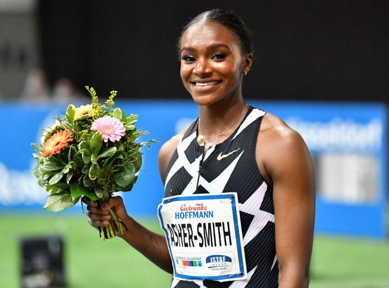 Asher-Smith celebrates winning the women's 60m final in Duesseldorf on Sunday