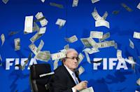 Former chief Sepp Blatter, mired in scandal before being banned from FIFA, made $3.6 million in 2015 (AFP Photo/Fabrice Coffrini)