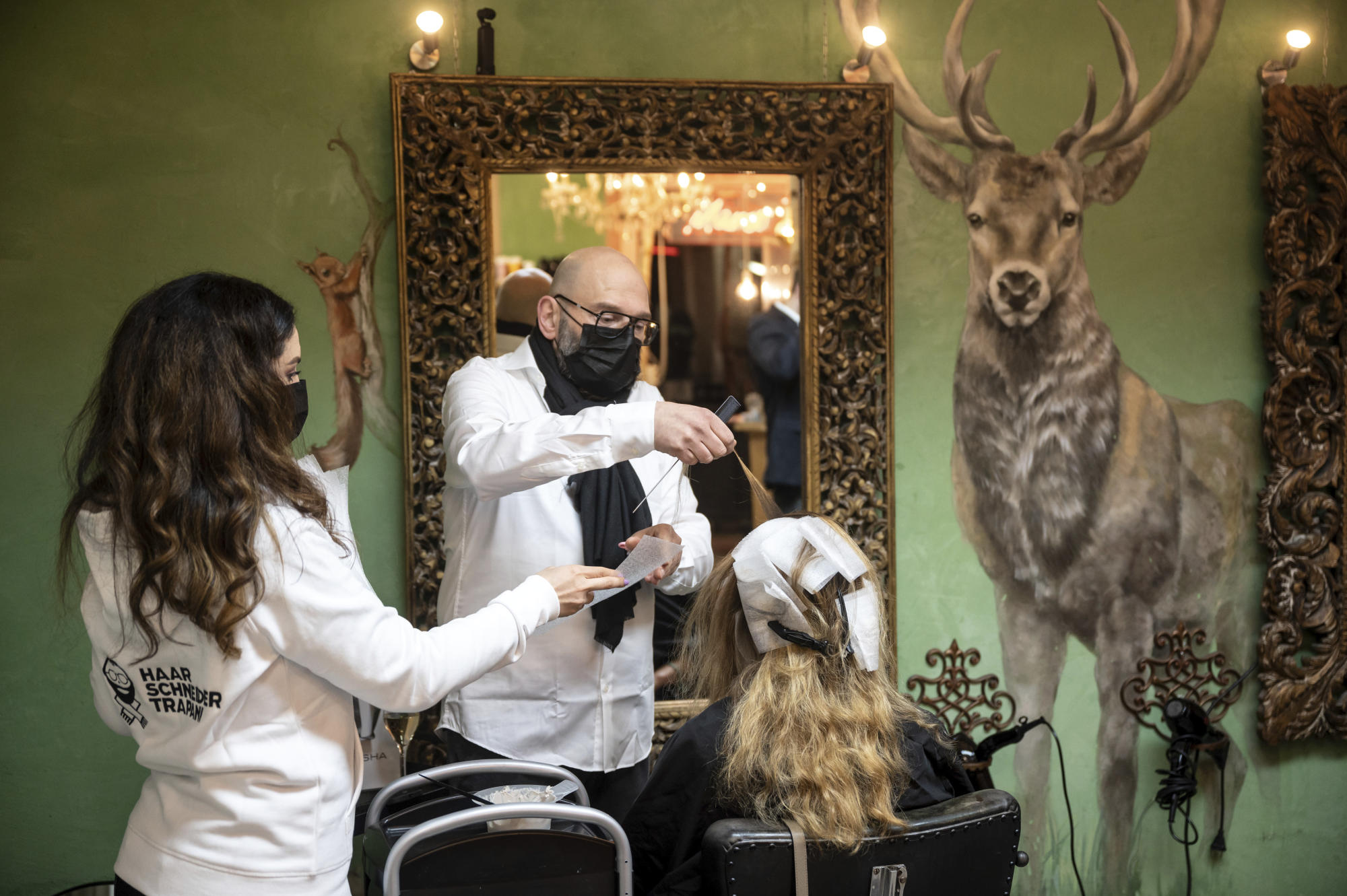 The Latest: German hair salons reopen as virus rules eased