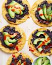 """<p>With only 5 ingredients these black bean tostadas are the easiest and fastest meal to throw together. </p><p>Get the recipe from <a href=""""https://www.delish.com/cooking/recipe-ideas/a35195090/black-bean-tostada-recipe/"""" rel=""""nofollow noopener"""" target=""""_blank"""" data-ylk=""""slk:Delish"""" class=""""link rapid-noclick-resp"""">Delish</a>. </p>"""