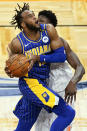 Indiana Pacers forward Oshae Brissett, left, draws a foul from Orlando Magic center Mo Bamba as he goes up for a shot during the first half of an NBA basketball game, Sunday, April 25, 2021, in Orlando, Fla. (AP Photo/John Raoux)