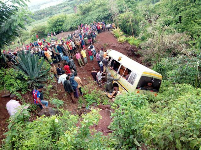 <p>Residents gather at the scene of an accident that killed schoolchildren, teachers and a minibus driver at the Rhota village along the Arusha-Karatu highway in Tanzania's northern tourist region of Arusha, May 6, 2017. (Photo: Emmanuel Herman/Reuters) </p>
