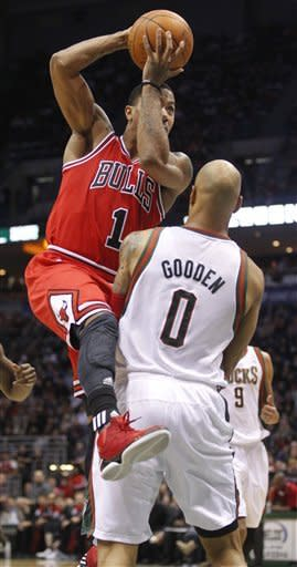 Chicago Bulls' Derrick Rose (1) drives to the basket past Milwaukee Bucks' Drew Gooden (0) during the second half of an NBA basketball game on Saturday, Feb. 4, 2012, in Milwaukee. (AP Photo/Jeffrey Phelps)