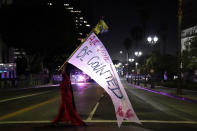 """A woman carries a sign that reads, """"all votes must be counted,"""" Wednesday, Nov. 4, 2020, in Los Angeles, after the Nov. 3 elections. (AP Photo/Jae C. Hong)"""