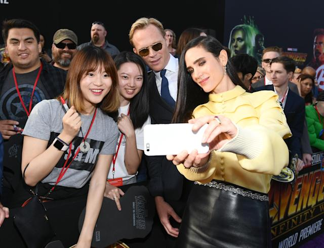 <p>The actor who plays Vision posed for fans while his actress wife was on camera duty. (Photo: Emma McIntyre/Getty Images) </p>