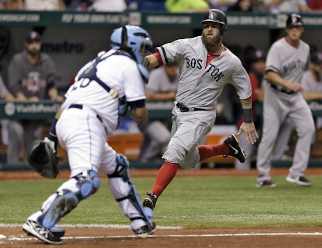 Boston Red Sox's Mike Napoli scores past Tampa Bay Rays catcher Jose Molina, left, on an RBI single by Jonny Gomes during the fifth inning baseball game Tuesday, Sept. 10, 2013, in St. Petersburg, Fla. (AP Photo/Chris O'Meara)