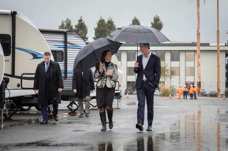 Oakland Mayor Libby Schaaf and California Governor Gavin Newsom tour a new site where the state will provide emergency housing for the homeless in Oakland, Calif.