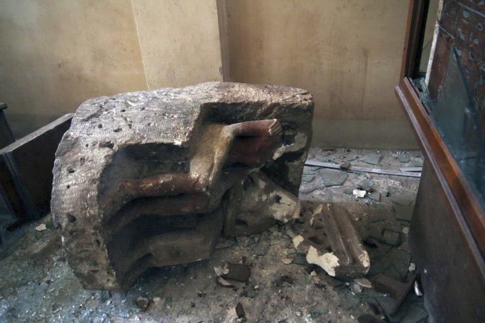 A damaged object lies on the floor of the Malawi Antiquities Museum after it was ransacked and looted between the evening of Thursday, Aug. 15 and the morning of Friday, Aug. 16, 2013, in Malawi, south of Minya, Egypt, Saturday, Aug. 17, 2013. The interim Cabinet authorized police to use deadly force against anyone targeting police and state institutions on Thursday. The violence capped off a week that saw more than 700 people killed across the country. (AP Photo/Roger Anis, El Shorouk Newspaper) EGYPT OUT