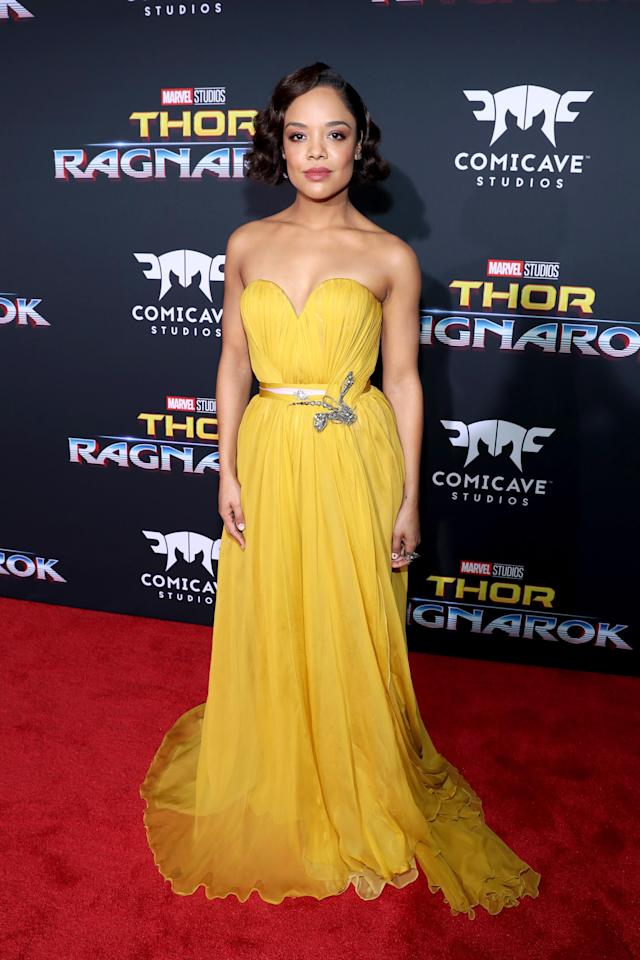 <p>Thompson complemented her co-star's look with another yellow-toned dress. The Schiaparelli look was just one of two dresses she wore throughout the night. (Photo: Getty Images) </p>