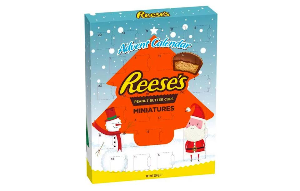 """<p>Reese's Pieces are bringing their peanut butter goodness to the UK, with a cup-filled advent calendar that'll be hard to put down.<br><a rel=""""nofollow noopener"""" href=""""https://www.sainsburys.co.uk/"""" target=""""_blank"""" data-ylk=""""slk:Sainsbury's, £5"""" class=""""link rapid-noclick-resp""""><i>Sainsbury's, £5</i></a> </p>"""
