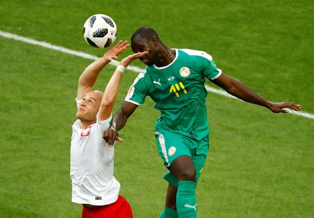 Soccer Football - World Cup - Group H - Poland vs Senegal - Spartak Stadium, Moscow, Russia - June 19, 2018 Poland's Michal Pazdan in action with Senegal's Moussa Konate REUTERS/Kai Pfaffenbach TPX IMAGES OF THE DAY