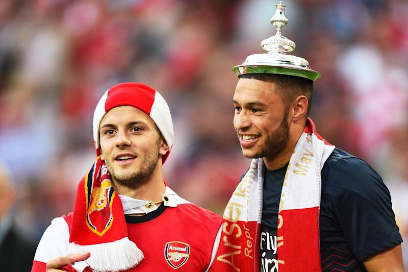 Oxlade-Chamberlain celebrates Arsenal's 2014 Cup victory with Jack Wilshere: Getty Images