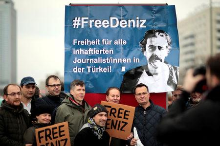 Protestors demonstrate, calling for the freedom of German-Turkish journalist Deniz Yucel, in the streets of Berlin