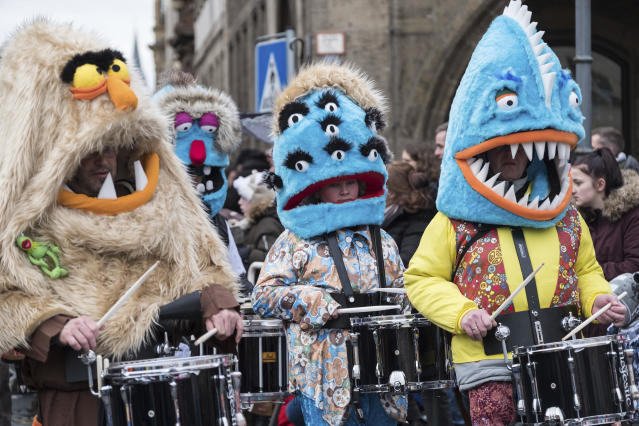 <p>A costumed brass band takes part in a carnival parade in Braunschweig, Germany, Feb. 11, 2018. (Peter Steffen/dpa via AP) </p>