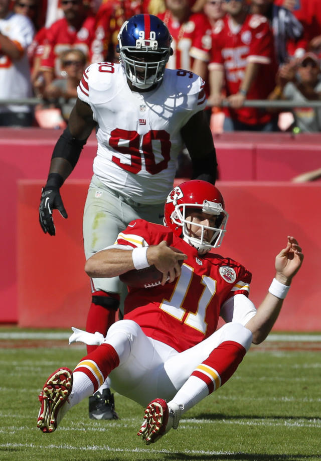 Kansas City Chiefs quarterback Alex Smith (11) slides down after getting past New York Giants defensive end Jason Pierre-Paul (90) during the first half of an NFL football game at Arrowhead Stadium in Kansas City, Mo., Sunday, Sept. 29, 2013. (AP Photo/Orlin Wagner)