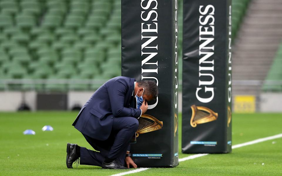 Italy head coach Franco Smith inspects the pitch before the 6 Nations match at the Aviva Stadium, Dublin. PA Photo. Picture date: Saturday October 24, 2020. - PA