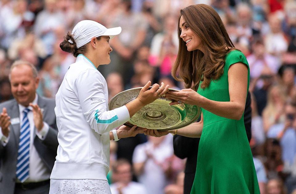 Ashleigh Barty of Australia is presented with the Venus Rosewater Dish trophy by HRH Catherine, The Duchess of Cambridge after winning her Ladies' Singles Final match against Karolina Pliskova of The Czech Republic on Day Twelve of The Championships - Wimbledon 2021