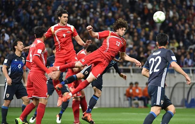 Syria in action against Japan in a 2018 World Cup Asian qualifier in Saitama on March 29, 2016 (AFP Photo/)