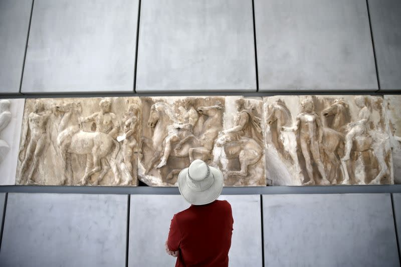 FILE PHOTO: A man looks at exhibits at the Parthenon hall of the Acropolis museum in Athens