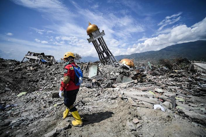 The death toll from the twin disaster on Sulawesi island that erased whole suburbs in Palu has reached 1,944 (AFP Photo/MOHD RASFAN)