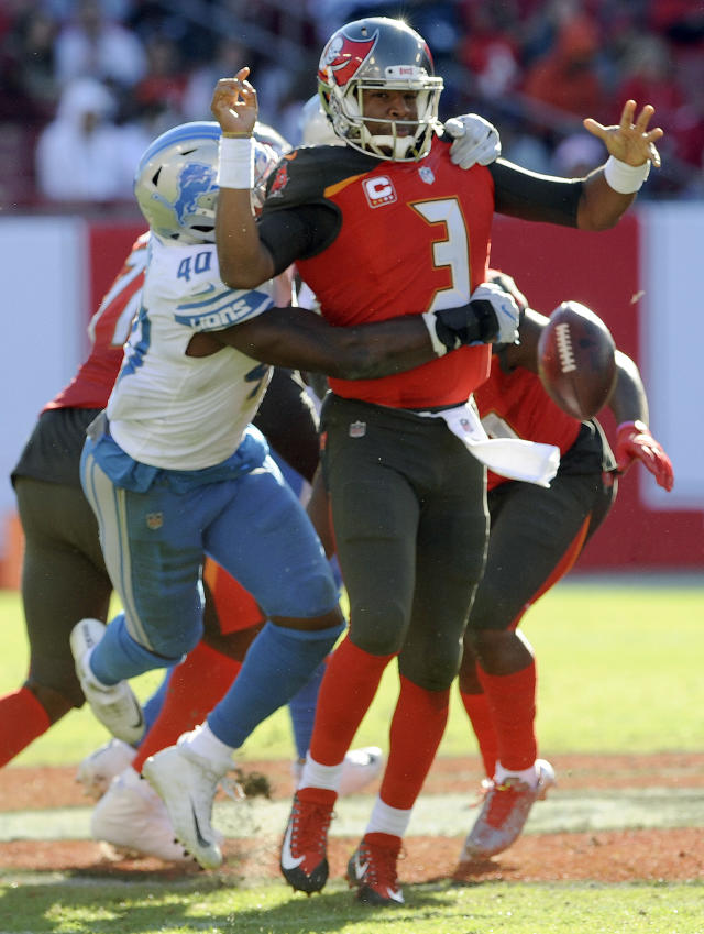 <p>Tampa Bay Buccaneers quarterback Jameis Winston (3) fumbles when he is hit by Detroit Lions linebacker Jarrad Davis (40) during the second half of an NFL football game Sunday, Dec. 10, 2017, in Tampa, Fla. Detroit recovered the fumble. (AP Photo/Steve Nesius) </p>