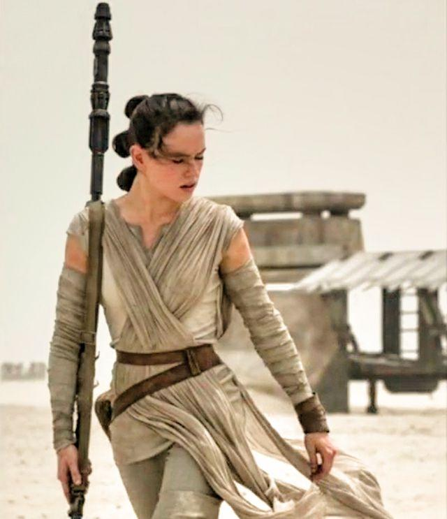 """<p>If you own a lot of beige, then you can easily DIY your own Rey costume. </p><p><strong>What You'll Need:</strong> <a href=""""https://www.amazon.com/Earnda-Womens-Leather-Fashion-Waist/dp/B07K781WK7/ref=sr_1_5?"""" target=""""_blank"""">Brown leather belt</a> ($15, amazon.com); <a href=""""https://www.amazon.com/Amazon-Essentials-Womens-2-Pack-Slim-Fit/dp/B0775PMBS1/ref=sr_1_7?keywords=beige+tank+top&qid=1565750459&s=apparel&sr=1-7"""" target=""""_blank"""">beige tank top</a> ($14, amazon.com); <a href=""""https://www.amazon.com/Ben-Textiles-Island-Breeze-Champagne/dp/B01MR2YORB/ref=sr_1_8?"""" target=""""_blank"""">cotton gauze</a> ($5, amazon.com)</p>"""