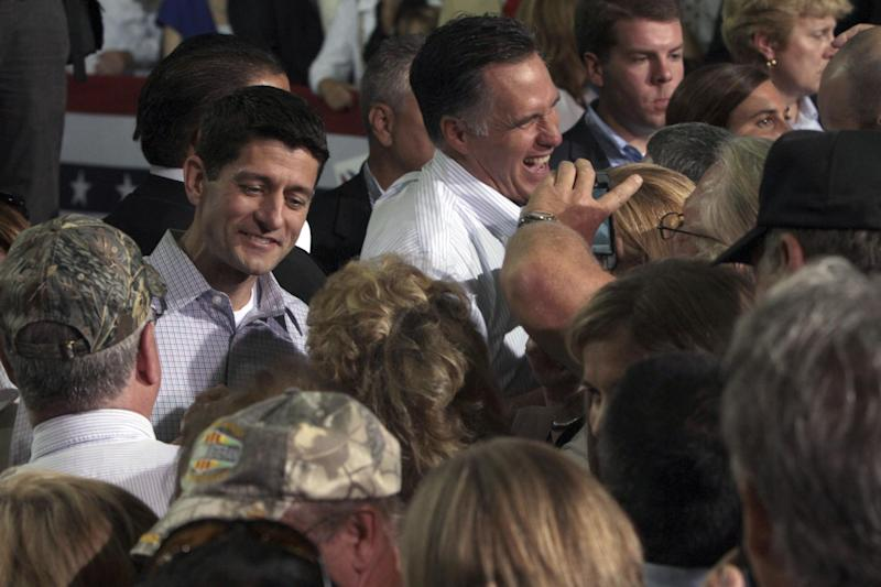 Republican presidential candidate, former Massachusetts Gov. Mitt Romney, background center, and vice presidential running mate Rep. Paul Ryan, R-Wis., second from left, greet supporters during a campaign event at the NASCAR Technical Institute, Sunday, Aug. 12, 2012, in Mooresville, N.C.  (AP Photo/Mary Altaffer)