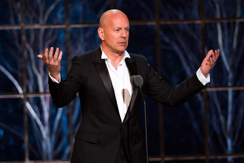 "FILE - In this March 26, 2011 photo, Bruce Willis appears onstage at the ""The Comedy Awards"" presented by Comedy Central in New York.  Willis says he's willing to give away his popular central Idaho ski resort to a nonprofit.  The action star has already put his lavish home in nearby Hailey, Idaho, on the real estate market, it's listed at $15 million, along with his local bar and nightclub, The Mint, listed at about $4 million.  (AP Photo/Charles Sykes)"