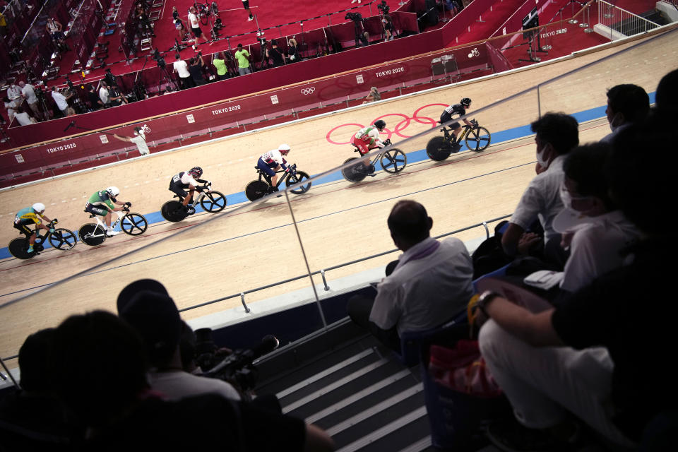 Athletes compete during the track cycling men's omnium tempo race at the 2020 Summer Olympics, Thursday, Aug. 5, 2021, in Izu, Japan. (AP Photo/Christophe Ena)