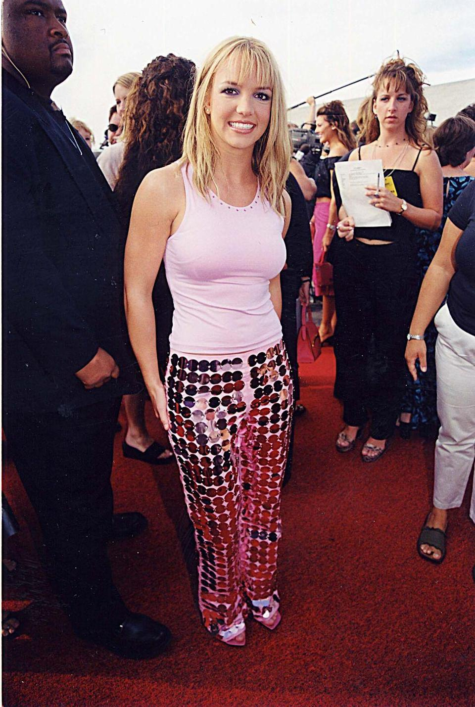 <p>The pop star wore these reflective pants and a pink tank to the Teen Choice Awards in '99. Who needs a disco ball when you're wearing an outfit like this? </p>