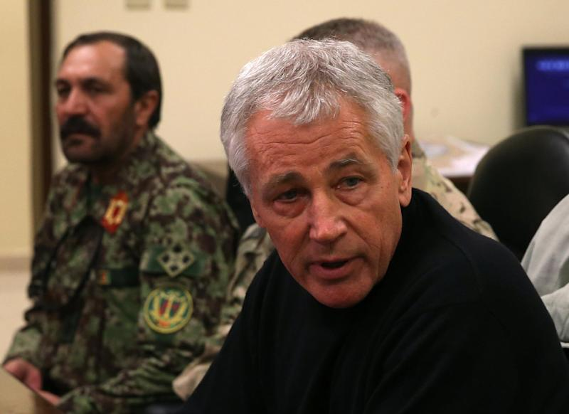 U.S. Secretary of Defense Chuck Hagel, right, speaks during a meeting with Afghan military leaders in Kandahar, Afghanistan, Sunday, Dec. 8, 2013. Hagel spoke with U.S. troops and thanked them for being deployed for the holidays. (AP Photo/Mark Wilson, Pool)