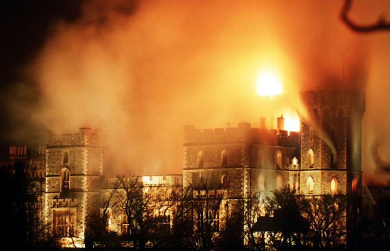 WINDSOR CASTLE BLAZE DISASTERS - Hours after the major fire started flames continue to rise over Windsor Castle, causing millions of pounds of damage. Windsor Castle 20 miles west of London is used by Britain's Queen Elizabeth II as a weekend home and contains many historic works of art. (AP-Photo/stf/Denis Paquin) 11/20/1992