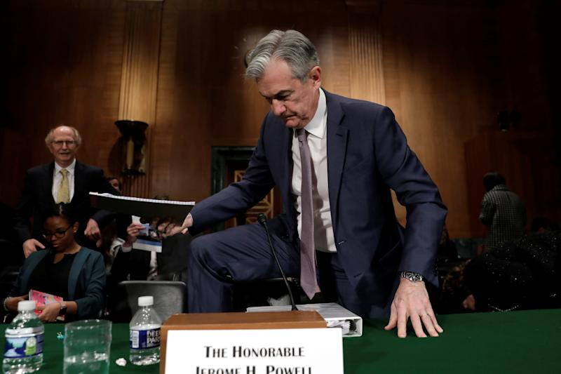 Federal Reserve Board Chairman Jerome Powell steps over a chair after a Senate Banking Committee hearing on The Semiannual Monetary Policy Report to the Congress on Capitol Hill in Washington, U.S., February 12, 2020. REUTERS/Yuri Gripas