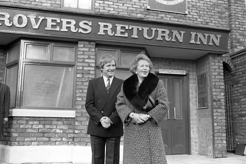 Prime Minister Margaret Thatcher outside the Rovers Return with William Roache, who plays Ken Barlow, on her visit to the Coronation Street set at Granada Studios, Manchester. (Photo by John Giles/PA Images via Getty Images)