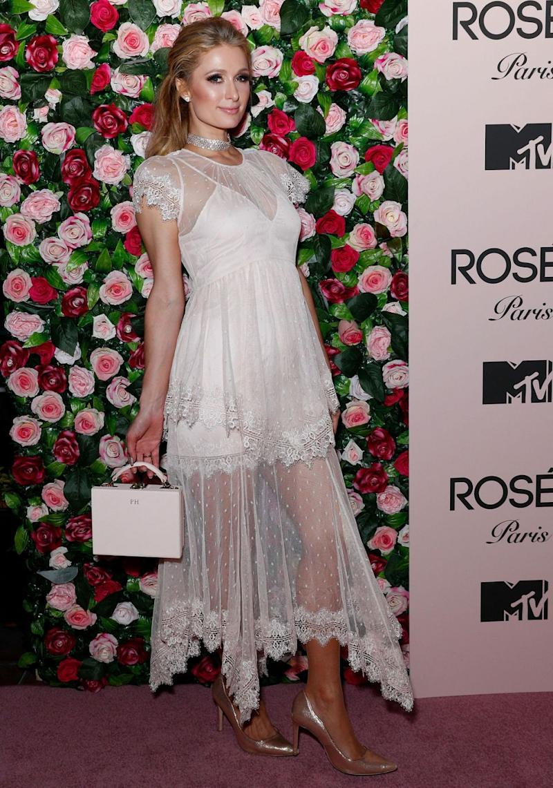 Paris Hilton says she doesn't remember whether Harvey Weinstein 'hit on her' at the amfAR Gala in 2001 - pictured here on Wednesday at a MTV event promoting her new fragrance Rose Rush. Source: Getty