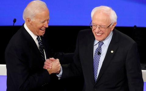 Democratic 2020 U.S. presidential candidates former Vice President Joe Biden greeets Senator Bernie Sanders as they take the stage for the seventh Democratic 2020 presidential debate at Drake University in Des Moines - Credit: Reuters