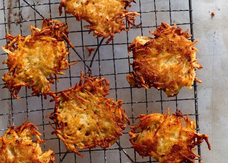 """Russets are ideal for this latke recipe. Their high starch content means you won't need flour to bind the pancakes. The result? More potato, and a crunchy (not cakey) texture. <a href=""""https://www.bonappetit.com/recipe/adam-maxines-famous-latkes?mbid=synd_yahoo_rss"""">See recipe.</a>"""