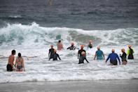 Sydney residents enjoy the waves at Bondi beach at the end of a 106-day lockdown (AFP/Saeed KHAN)