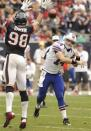 Buffalo Bills quarterback Ryan Fitzpatrick (14) has a pass deflected by Houston Texans' Connor Barwin (98) in the third quarter of an NFL football game on Sunday, Nov. 4, 2012, in Houston. (AP Photo/Dave Einsel)