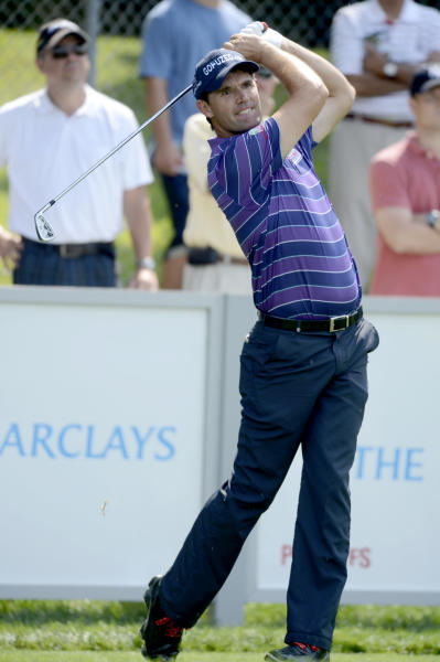 Padraig Harrington of Ireland, hits his drive on the 17th hole during the first round of The Barclays golf tournament at Bethpage State Park in Farmingdale, N.Y., Thursday, Aug. 23, 2012. (AP Photos/Henny Ray Abrams)