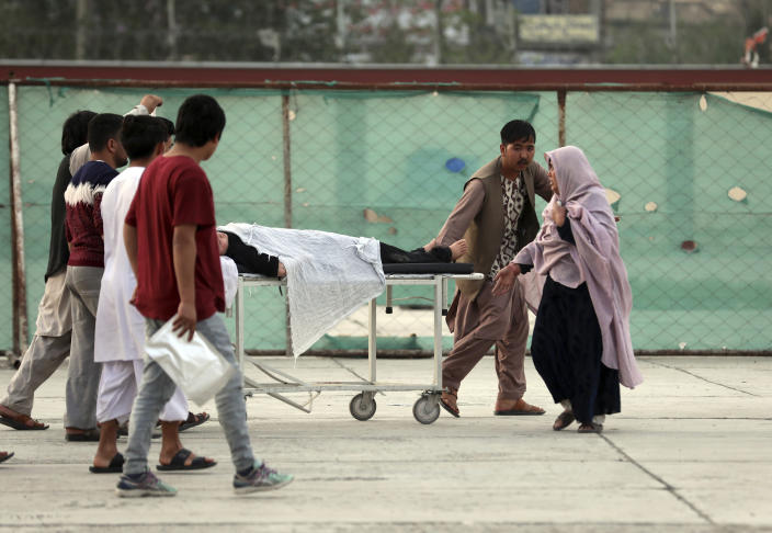An injured school student is transported to a hospital after a bomb explosion near a school west of Kabul, Afghanistan, Saturday, May 8, 2021. A bomb exploded near a school in west Kabul on Saturday, killing several, many them young students, Afghan government spokesmen said. (AP Photo/Rahmat Gul)